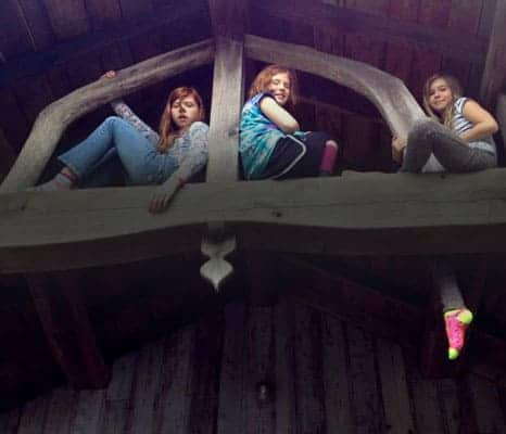 girls-sitting-on-beams